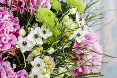 Bouquet of pink carnation, arabian star flower (ornithogalum ara. Bicum) and green chrysanthemums. Party decoration Stock Photography