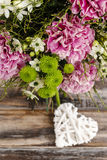 Bouquet of pink carnation, arabian star flower (ornithogalum ara. Bicum) and green chrysanthemums. Party decoration Stock Images