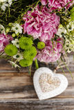 Bouquet of pink carnation, arabian star flower (ornithogalum ara. Bicum) and green chrysanthemums. Party decoration Royalty Free Stock Image