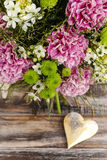 Bouquet of pink carnation, arabian star flower (ornithogalum ara. Bicum) and green chrysanthemums. Party decoration Stock Photo