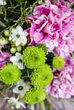 Bouquet of pink carnation, arabian star and green chrysanthemums. Bouquet of pink carnation, arabian star flower (ornithogalum arabicum) and green chrysanthemums Stock Photo
