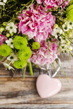 Bouquet of pink carnation, arabian star and green chrysanthemums Royalty Free Stock Photos