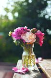 Bouquet of pink and cream peonies in a vase. stock photos