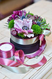 Bouquet with pink flower in a box with ribbons Stock Photos