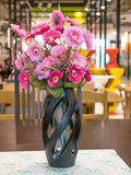 Bouquet of pink flower in vase on table Stock Photo