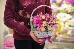 Bouquet of pink flowers in basket Royalty Free Stock Photo