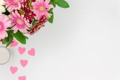 Bouquet of pink flowers with hearts on white background to view copy space stock image