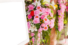 Bouquet pink flowers and photo frame white Stock Images