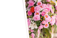 Bouquet pink flowers and photo frame white Royalty Free Stock Photos