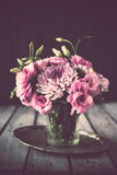 Bouquet of pink flowers in vase vintage decor Stock Images