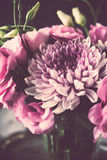 Bouquet of pink flowers in vase vintage decor Stock Photography