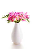 Bouquet of pink flowers in a white vase Royalty Free Stock Image