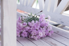 Bouquet of pink flowers on a white wooden background Royalty Free Stock Images