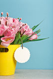Bouquet of pink fresh tulips with pussy-willow in yellow bucket Stock Photo