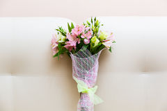 Bouquet of pink and green flowers. On white sofa Stock Images