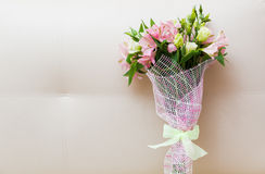 Bouquet of pink and green flowers. On white sofa Stock Image