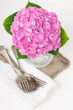 Pink hydrangeas and vintage cutlery Stock Image