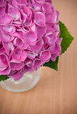 Pink hydrangeas on a wooden table Royalty Free Stock Photography