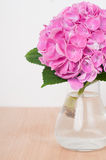 Pink hydrangeas on a wooden table Stock Images
