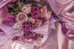 Bouquet of pink and lilac roses. Delicate bouquet of pink and lilac roses. Beautiful reflection, subtle shades Stock Image