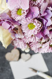 Bouquet of pink orchids, chrysanthemums and hortensias mixed wit Royalty Free Stock Image