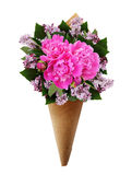 Bouquet of pink peonies and lilac flowers in a craft paper corne Royalty Free Stock Images