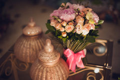 Bouquet of pink peonies  on table Stock Photo