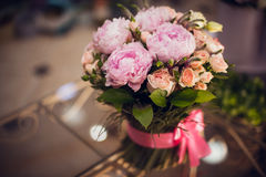 Bouquet of pink peonies  on table Stock Image