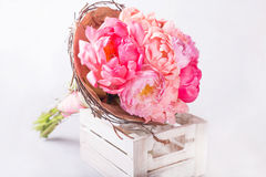 Bouquet of pink peonies in white wodden box. Still life with colorful flowers. Fresh peonies. Place for text. Flower concept. Fres Stock Photos