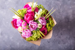 Bouquet of pink peonies in white wodden box. Still life with colorful flowers. Fresh peonies. Place for text. Flower concept. Fres Stock Photography