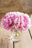 Bouquet of pink peonies on wooden table Stock Images
