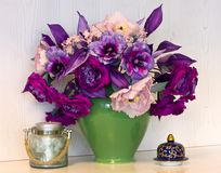 Bouquet of pink and purple peonies. Artificial flowers made of s. Ilk in the black vase royalty free stock images