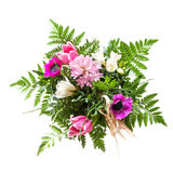 Bouquet of pink and purple spring flowers  isolated on white. Bouquet of bright pink and purple spring flowers  isolated on a white background, view from above Stock Photos