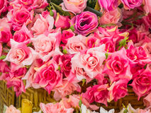 Bouquet of pink roses in a basket Stock Photos