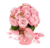Bouquet of pink roses in a basket with a gift Stock Image