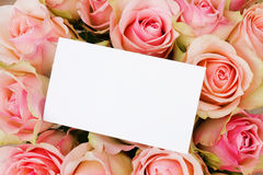Bouquet of pink  roses in basketwith greeting card Royalty Free Stock Photography