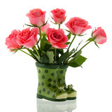 Bouquet pink roses in boots Royalty Free Stock Image