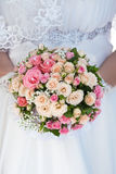 Bouquet of pink roses in the bride's hands Royalty Free Stock Photo