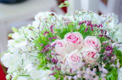 A bouquet of pink roses with pink cactus flowers. Surrounded by white orchids stock photos