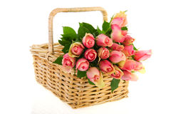 Bouquet pink roses in cane basket Stock Images