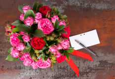 Bouquet of pink roses with gift tag. And red ribbon in a concept of love, romance, anniversary , Valentines day or wedding Stock Photography