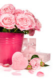 Bouquet of pink roses and gifts isolated on white Royalty Free Stock Photo