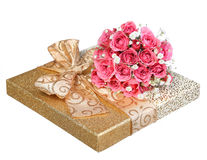 Bouquet of Pink Roses and Gold Gift Box isolated on white Royalty Free Stock Images