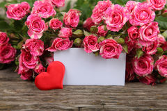 Bouquet of pink roses, heart  and greeting card Stock Image