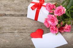 Bouquet of pink roses, heart  and greeting card Stock Photo