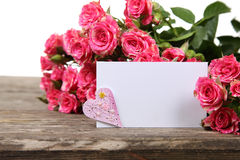 Bouquet of pink roses, heart  and greeting card Stock Images