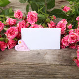 Bouquet of pink roses, heart  and greeting card Royalty Free Stock Images