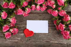 Bouquet of pink roses, heart  and greeting card Stock Photography