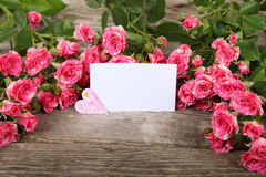 Bouquet of pink roses, heart  and greeting card Royalty Free Stock Image