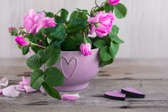 Bouquet of pink roses and hearts. royalty free stock photos